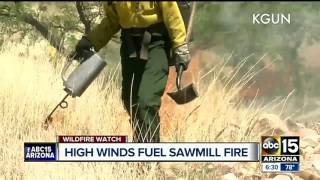 High winds continue to fuel Sawmill fire