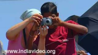 Boy with tourist at Vizhinjam beach