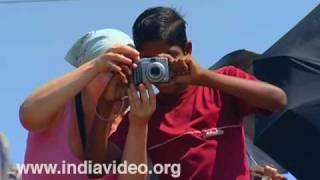 Boy with tourist at Vizhinjam beach