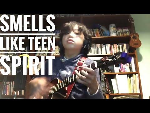 Lapsi soittelee taidokkaasti Nirvanaa ukulelella