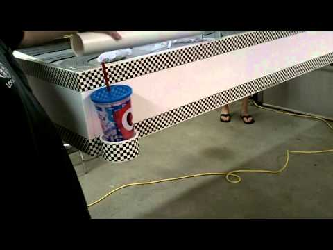 Slot car track that lifts into ceiling
