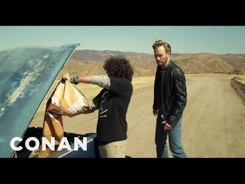 Watch Conan O'Brien Drive A Car Filled With Explosives Off A Cliff