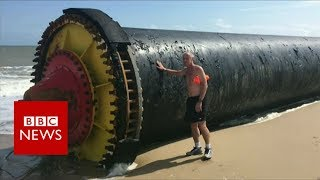 Giant pipes wash up on beaches - BBC News