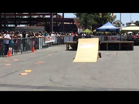 Losi Five-T and Losi 1/5 Desert Buggy Nitro RC cars doing ramp jumps at RCX show 2014