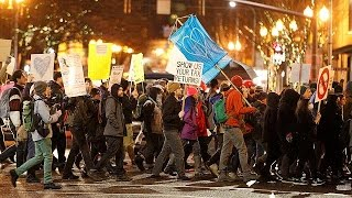 Outbursts of violence mar otherwise peaceful anti-Trump protest