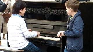 """Piano prodigy kid performing on """"Session street"""" in Lviv"""