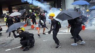 video: Hong Kong police fire water cannon and tear gas as protesters defy rally ban with petrol bombs