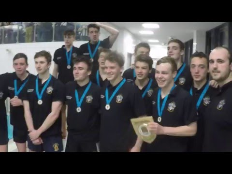 The U18 Water Polo Team line up with the Winning Trophy