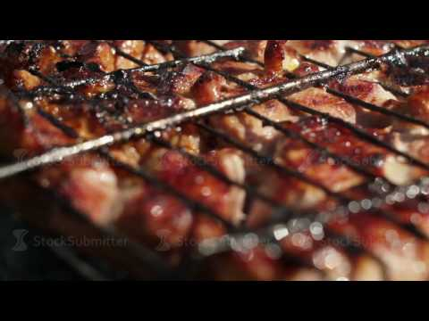 Pork barbecue. BBQ. Grilled meat ready for eating. Closeup