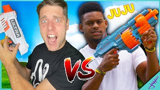 Challenging PRO Football + Soccer Player to NERF BATTLE!