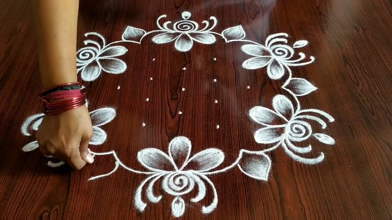 flower kolam rangoli design 7*4 dots by simple and easy rangoli