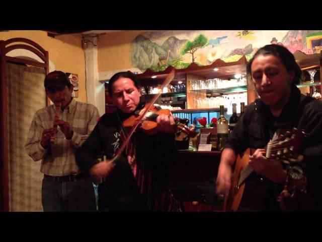 Ecuadorian folk music plays by street musicians in Banos, Ecuador.