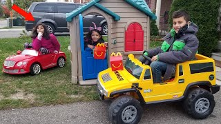Playing restaurant drive thru in our playhouse and Power Wheels Car