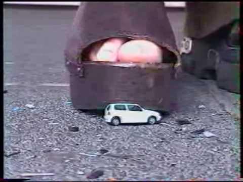 women crushing toy cars