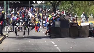 Venezuela: Rage spills over at protest against economic crisis, police death
