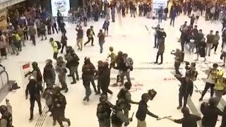 Hong Kong police scuffle with, arrest protesters at shopping mall