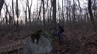 7 foot tall A frame rock is right next to the existing singletrack trail. Speed and commitment are your friend, as is a good chainring protector.