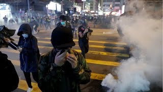 Hong Kong police fire tear gas at protesters during Christmas Day demonstrations