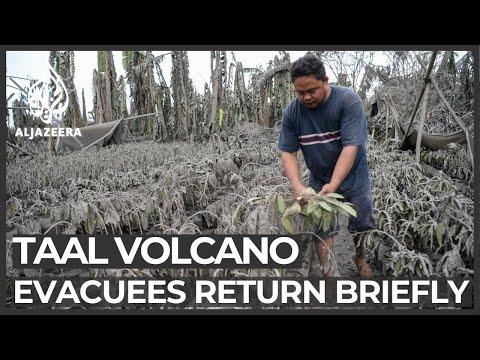 Philippines volcano: Evacuees return to collect belongings