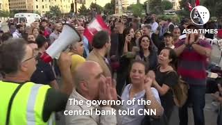 Lebanese mass protests topple government