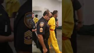 Tavores Henderson led to court in handcuffs belonging to officer he's accused of killing