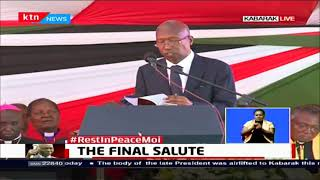 THE FINAL SALUTE: Philip Moi leads mourners in reading scriptures during Mzee Moi's burial
