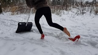 cleans snow with a shovel in louboutin, louboutin in the forest, high heels in snow (scene 132)