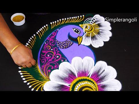 simple freehand peacock rangoli design