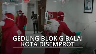 Kasus Positif Dikalangan Pejabat, Petugas Semprot Gedung Blok G Balai Kota DKI Pakai Disinfektan