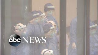 London flight placed on lockdown after passenger shows symptoms of coronavirus   ABC News