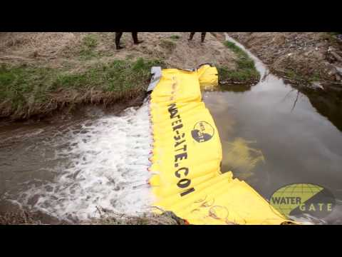 Using the Water-Gate for underflow damming - with release holes