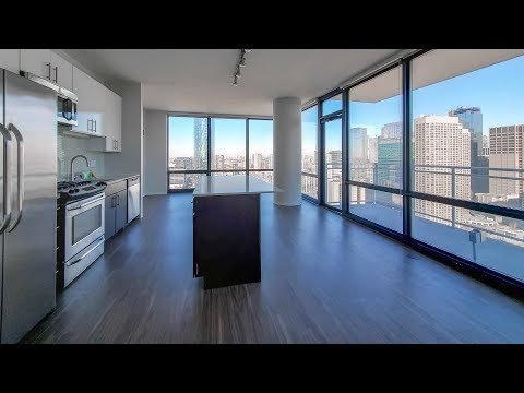 An -01 skyline-view 2-bedroom at the full-amenity Arkadia West Loop