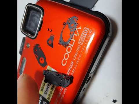 Nikon Coolpix AW100 разбираем в том числе диафрагму и затвор.
