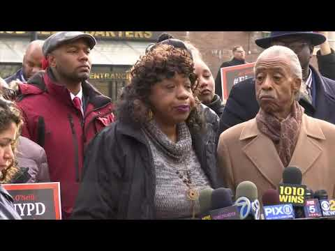 A New York City police officer accused in the death of an unarmed black man will face a disciplinary hearing in May. The family of Eric Garner appeared outside police headquarters following Thursday's hearing. (Dec. 6)