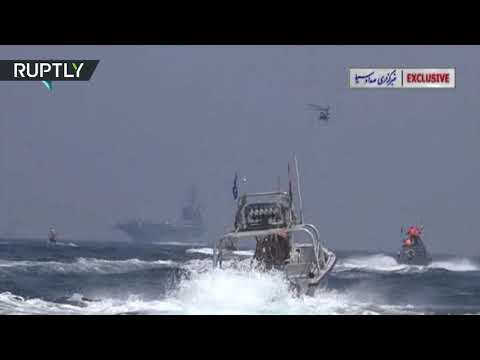 Iranian speedboats chase US aircraft carrier in Hormuz Strait