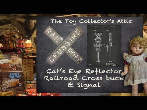 Railroad Crossing Cross Buck Sign With Cat's Eye Reflectors