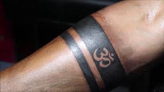 Plain Armband Tattoo With Solid Black Filling With Om In Between