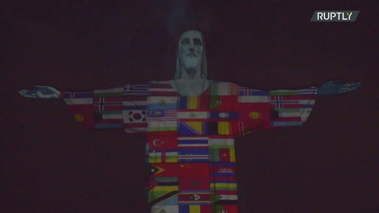 Το άγαλμα του Χριστού στο Ρίο φωτίστηκε με τις σημαίες των χωρών που «χτύπησε» ο κορονοϊός