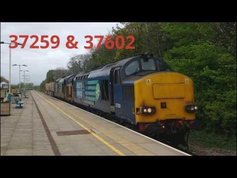 DRS 37259 & 37602 pass Prestatyn Station with nuclear flasks…