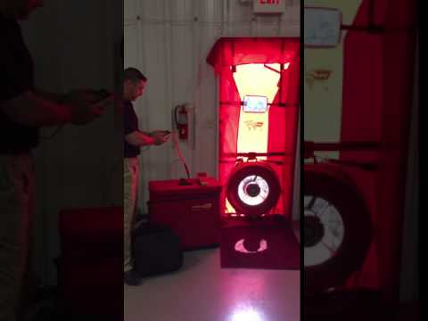 During a blower door test, the fan pulls air out of the house, lowering the pressure inside.  The higher outside air pressure then flows in through all unsealed cracks and openings.