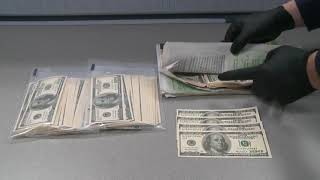 RAW: Fake U.S. money seized at Edmonton International Airport
