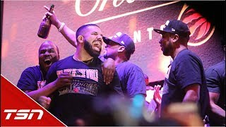 Drake celebrates with fans in Jurassic Park after Raptors win title