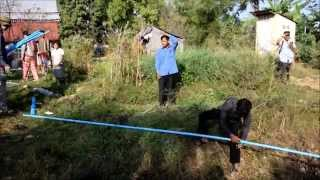 preview picture of video 'Treadle pump demonstration, at Pouthi Reach villag'