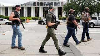 Armed group gathers and walks through downtown Raleigh