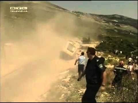 Dude nearly gets hit by a runaway train car going down a mountain.