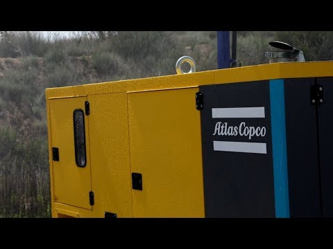 Rain test on waterproof diesel power generator for construction, industry and events Atlas Copco - zdjęcie