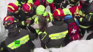 Italian rescuers pull mother & child free from hole in snow