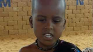 Somali children sing at a Child Friendly Space in Dollow IDP camp