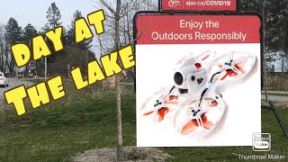 FPV drone flight near the lake on a quiet parking lot Emax Tiny Hawk 2