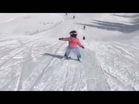 Amazing Little Girl Joyfully Skis Downhill
